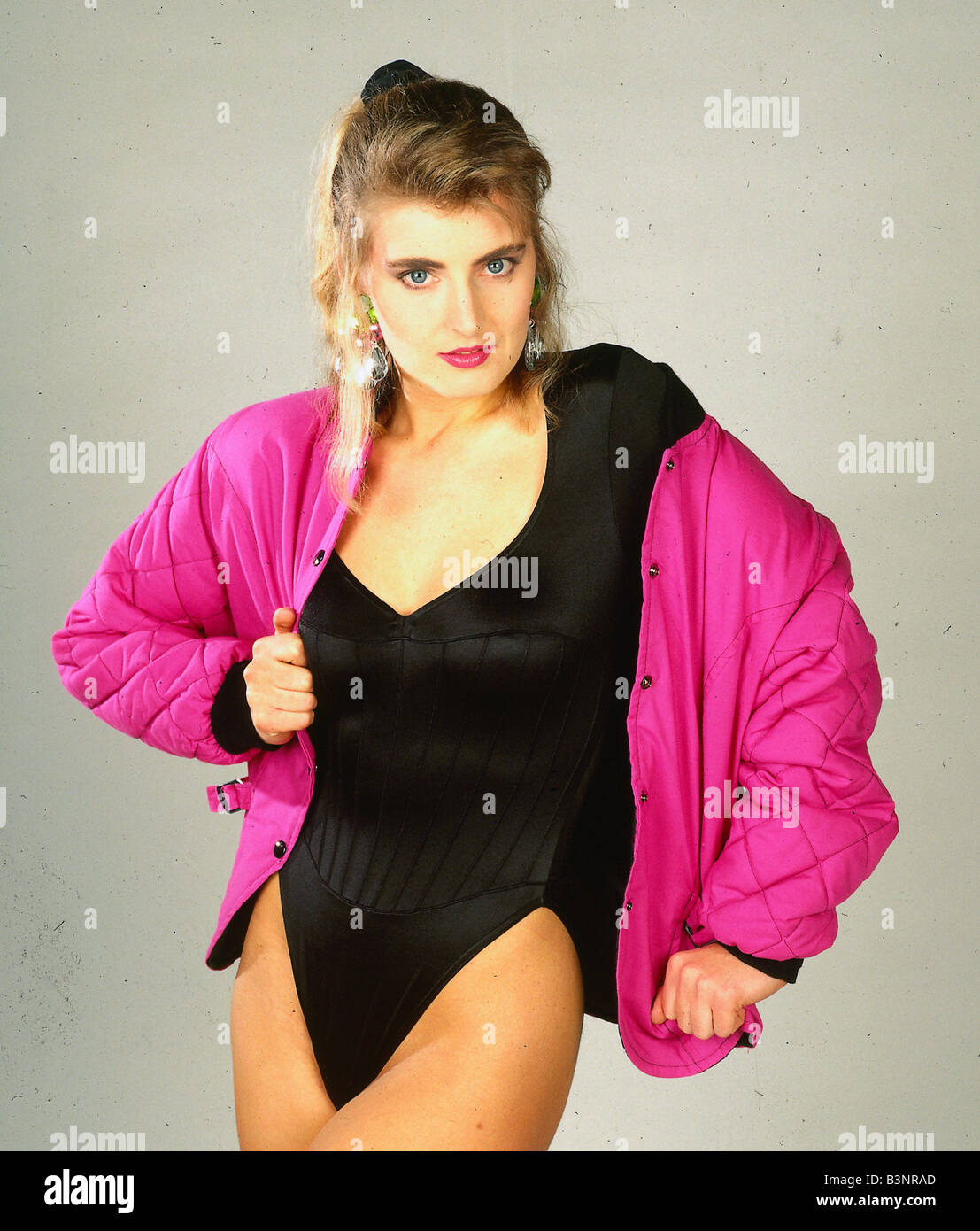 1990s Fashion Stock Photos   1990s Fashion Stock Images   Alamy Jacket Fashion model wears pink padded bomber jacket April 1991 black  bodysuit   Stock Image