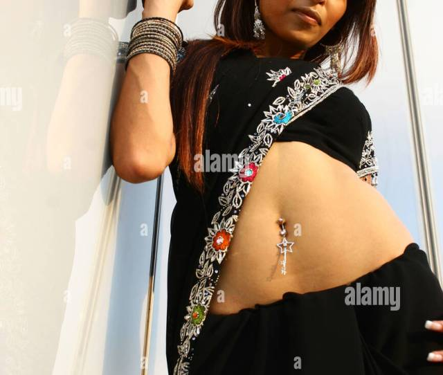 Desi Indian Woman Portrait Leaning On Glass Wall