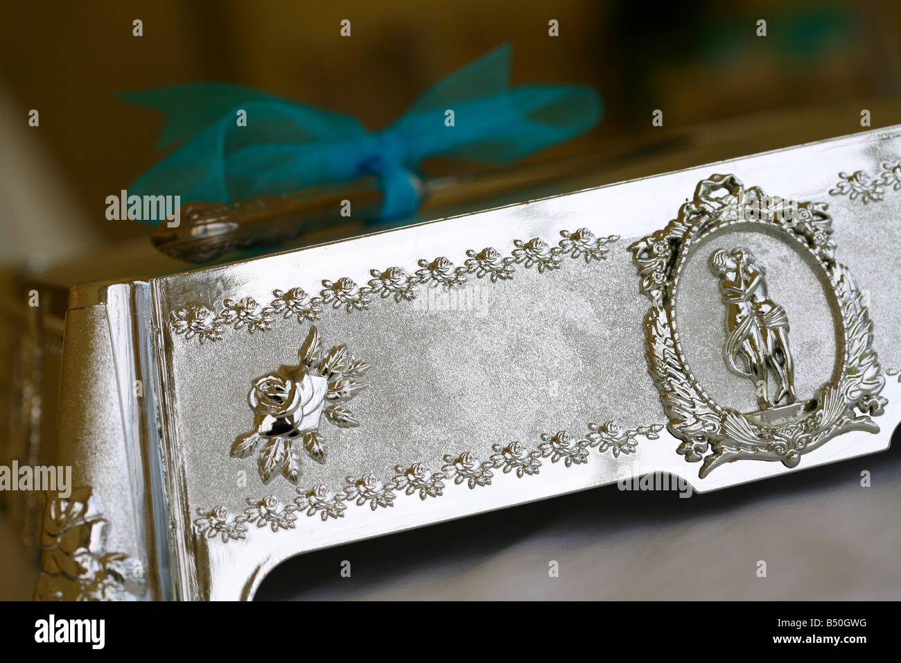 Silver wedding cake stand   knife blue bow Stock Photo  20296908   Alamy Silver wedding cake stand   knife blue bow