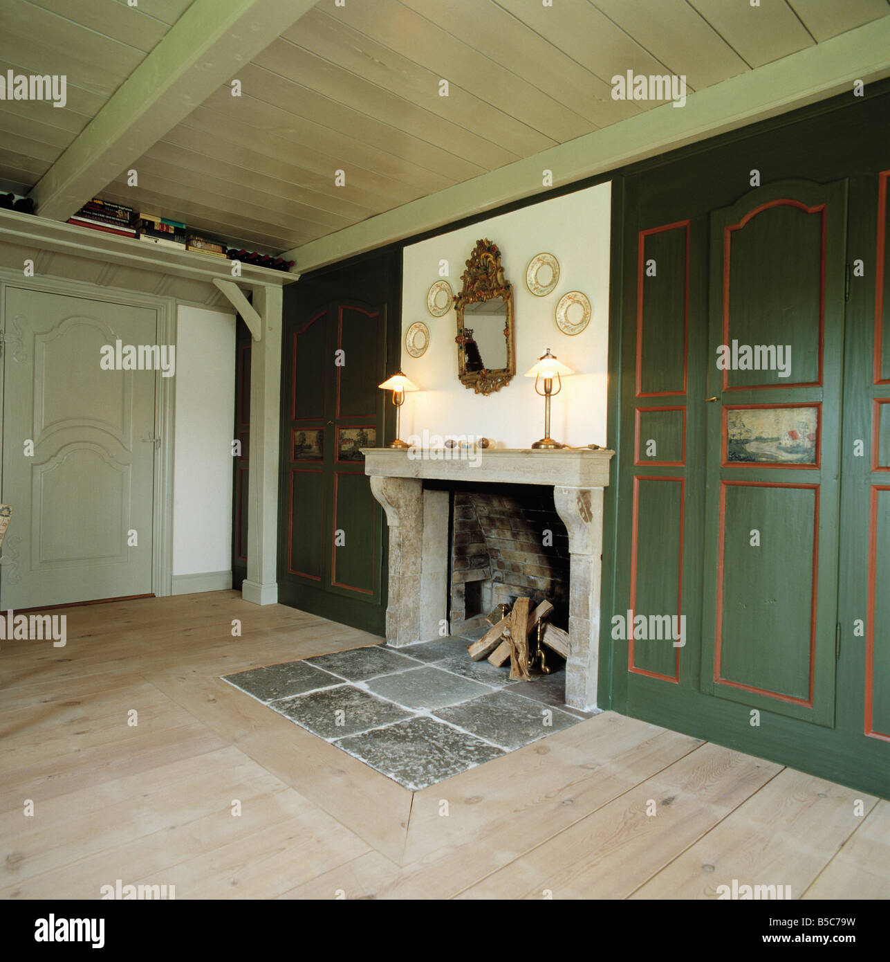 https www alamy com stock photo slate tiles set into wooden floor in front of fireplace with stone 20552837 html