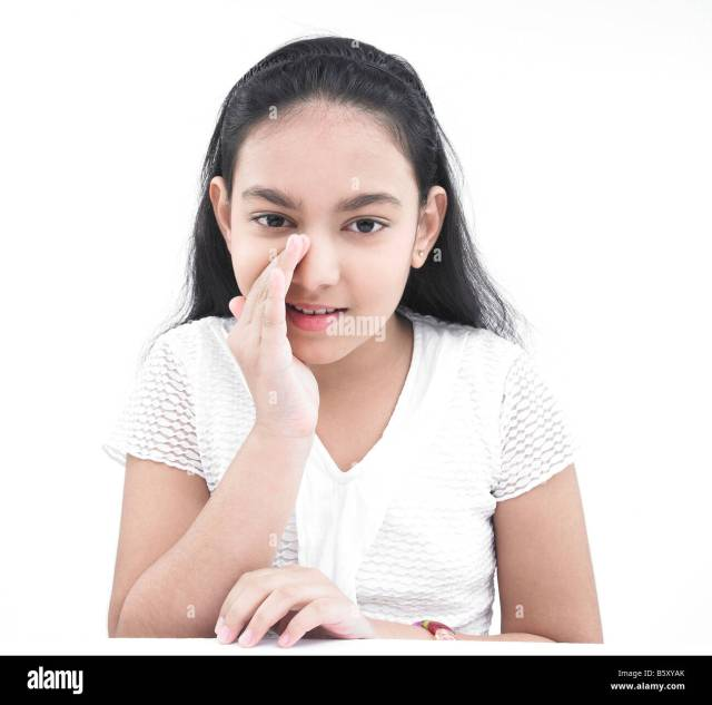 Portrait Of An Asian Teenage Girl Of Indian Origin Whispering Stock Image