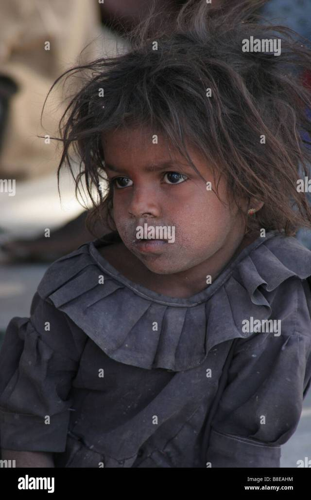 Young Dirty Indian Girl Listens To A Village Meeting