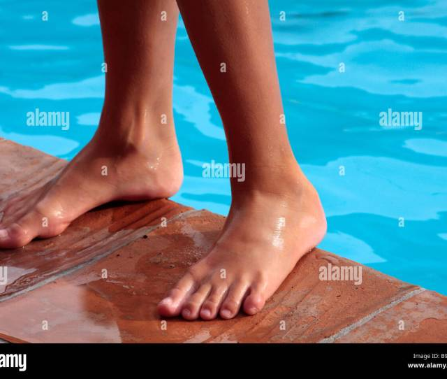 Boys Feet By A Swimming Pool