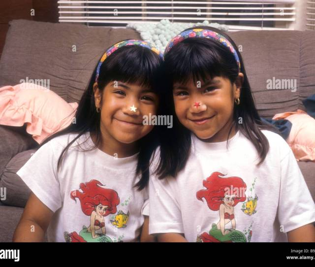 Twin Latina Girls Hug Touch Smile Love Sister Hispanic Portrait Happy Enjoy Share Together Sibling Face