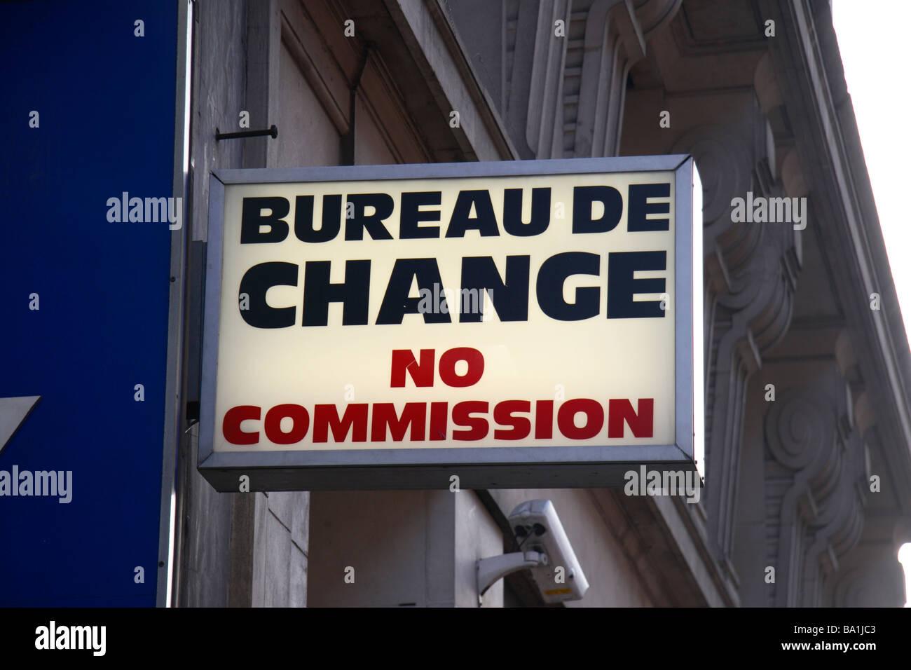 a generic bureau de change no commission sign above a shop on oxford street london