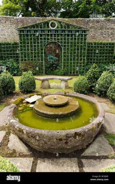 english garden fountains water features Trellis with boxed hedges and water feature in an English