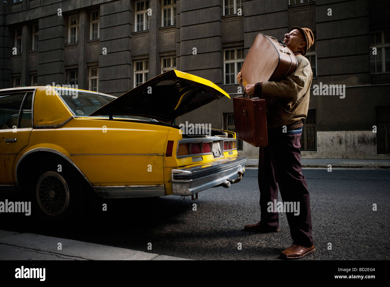Taxi Driver Struggling With Luggage Stock Photo