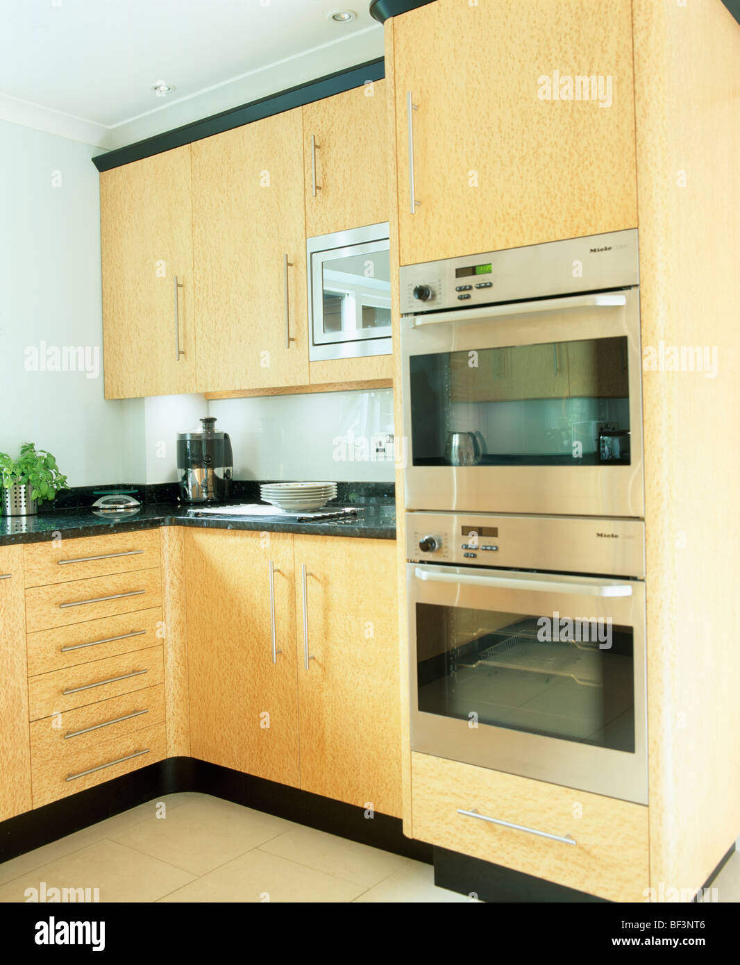 Eye Level Double Oven In Modern Kitchen With Pale Wood