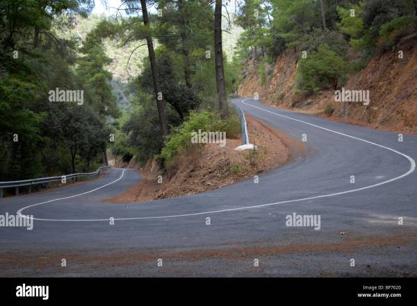 twisty hairpin bend in a mountain road in the troodos ...