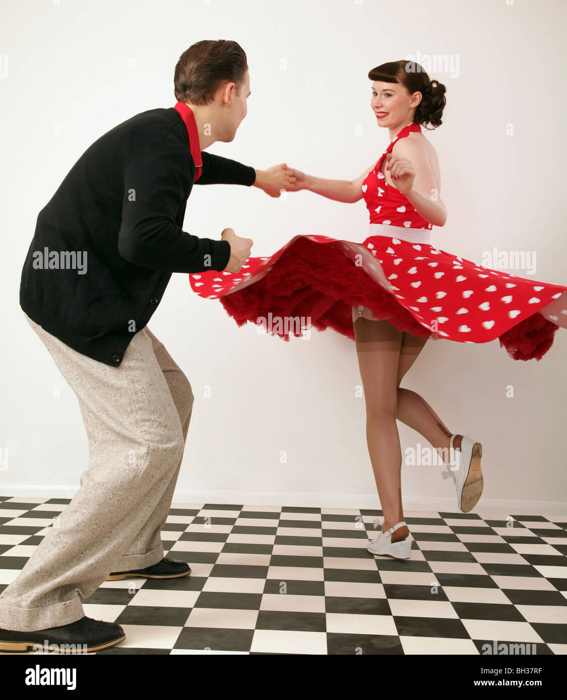 Boy And Girl In 1950s Clothes Dancing Stock Photo