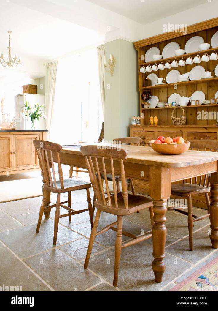 old pine table and chairs in country kitchen with pine dresser and