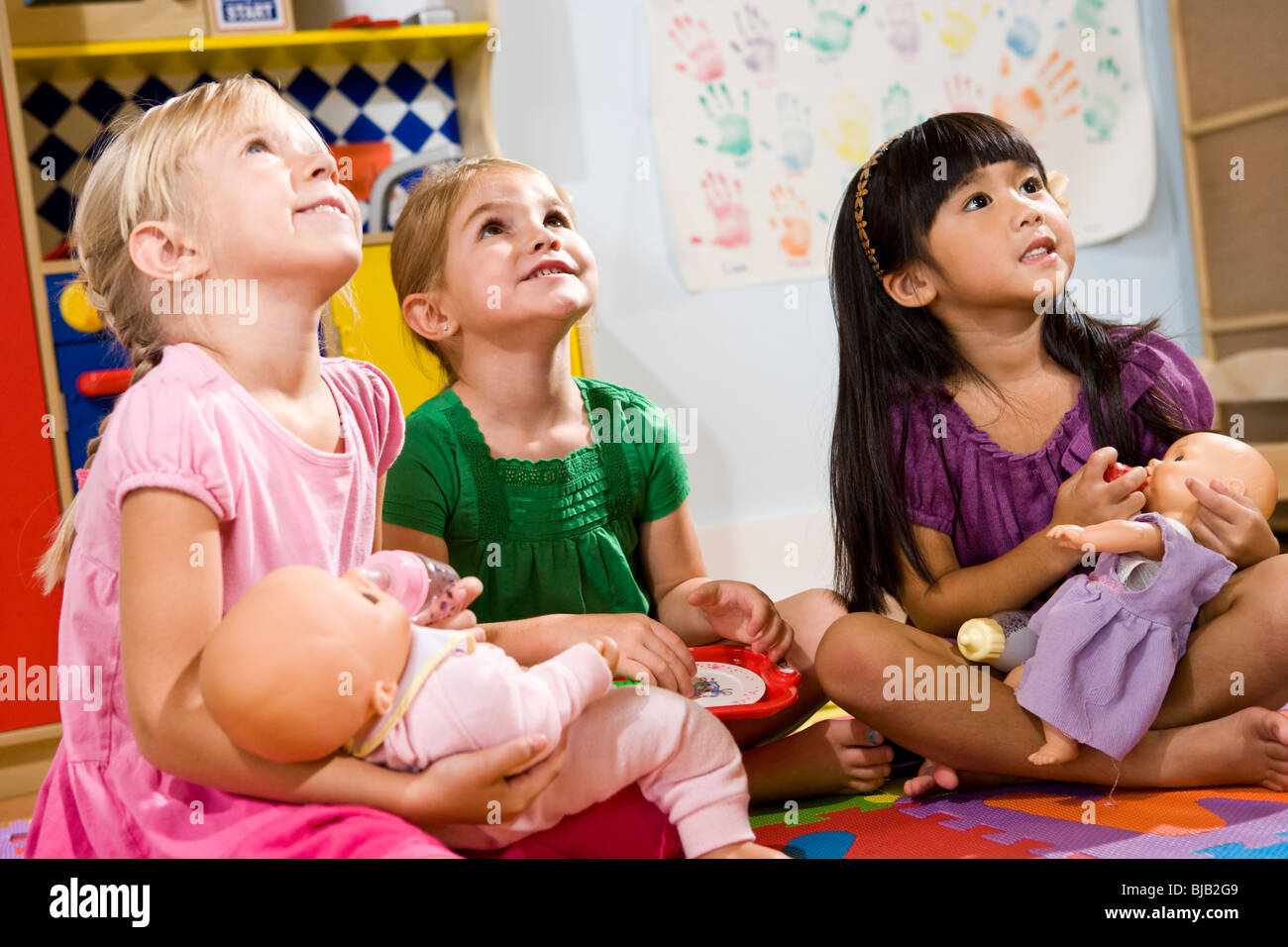 Little Preschool Girls Playing With Dolls Stock Photo