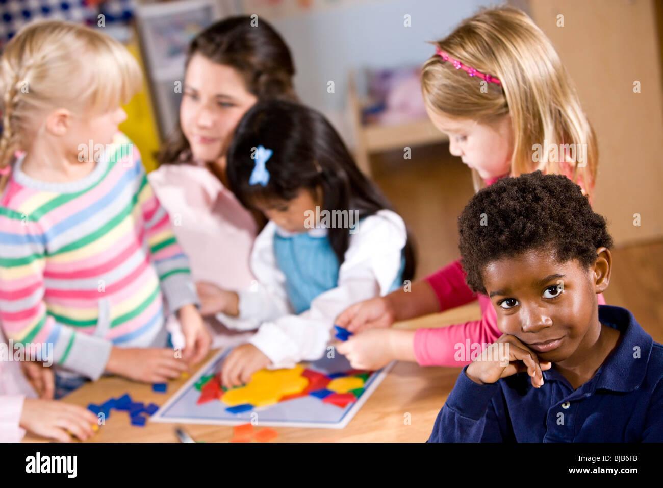 African American Boy In Preschool Kids And Teacher In