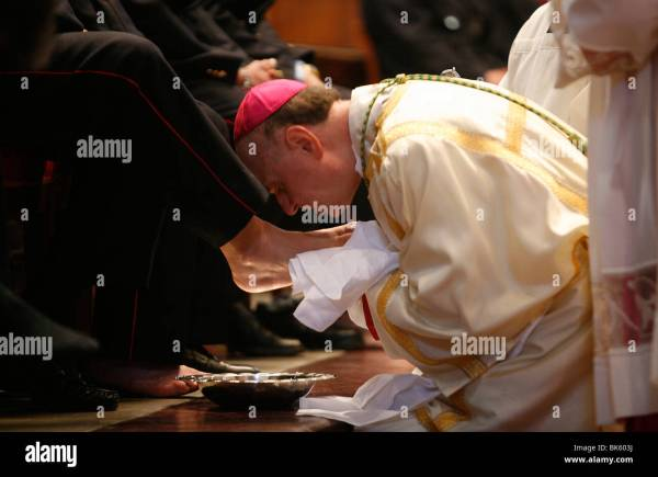 Bishop kissing feet after washing them, Easter Thursday ...