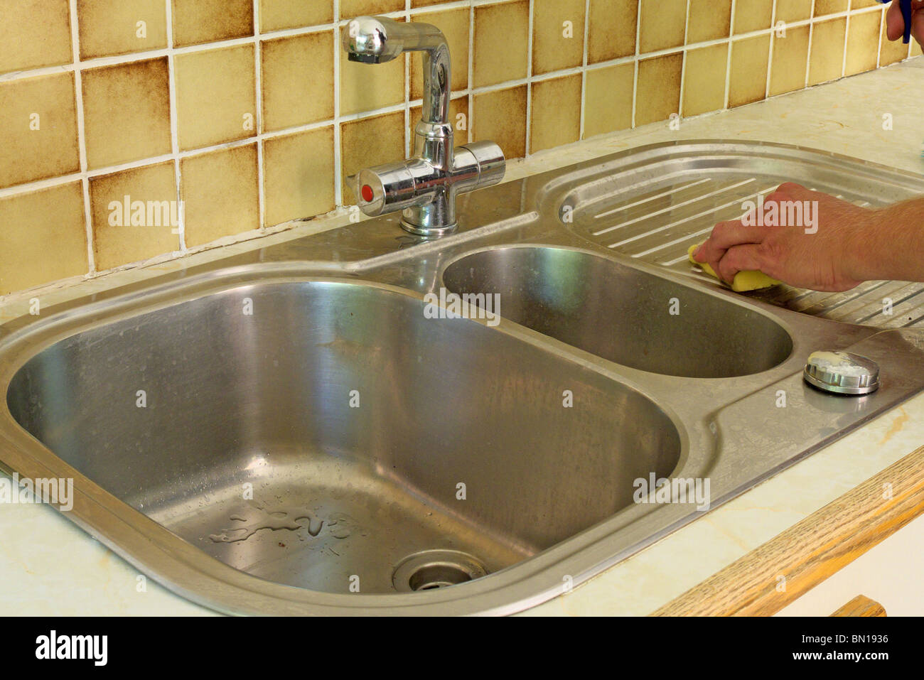 https www alamy com stock photo man cleaning stainless steel kitchen sink model released 30147242 html