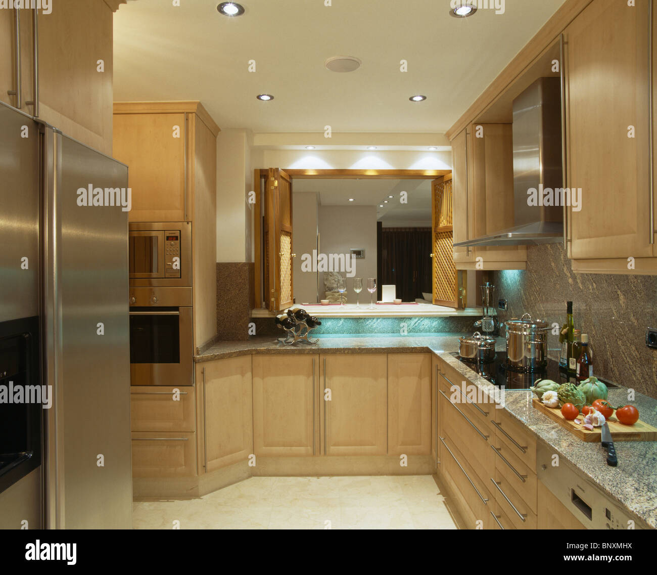 https www alamy com stock photo recessed lighting in modern in modern spanish kitchen with pale wood 30705078 html