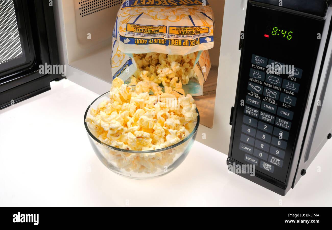 https www alamy com stock photo open bag of pop secret microwave popcorn inside microwave with a glass 31471898 html