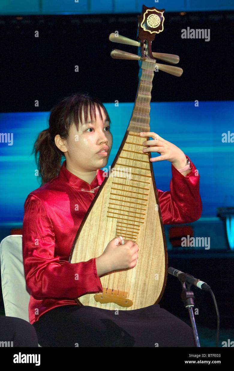 young woman playing four stringed ancient chinese lute family stock
