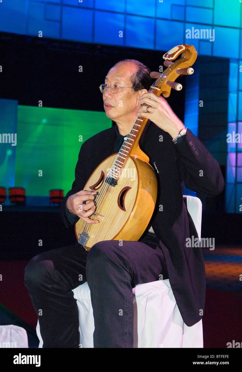 man playing four stringed ancient chinese lute guitar family stock