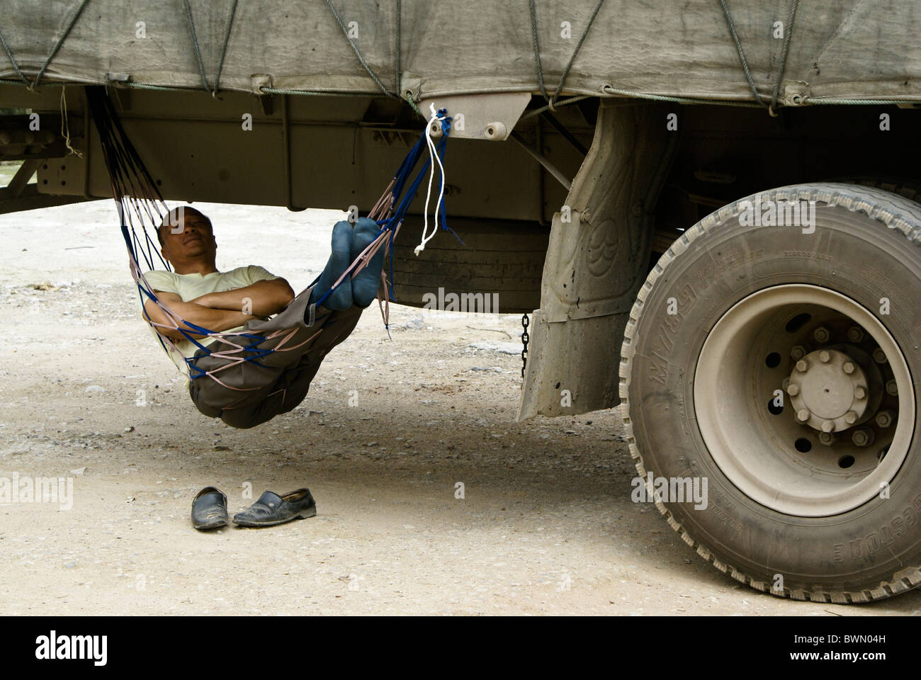 Man Sleeping In Hammock Under His Truck Fuli Guangxi