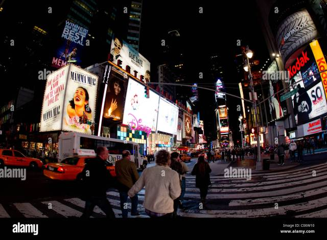 Hustle And Bustle Of A Street Scene In New York City In The Pre Dawn Hours