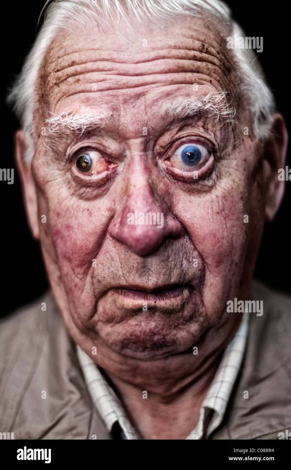 Portrait of an old man pulling a face Stock Photo ...