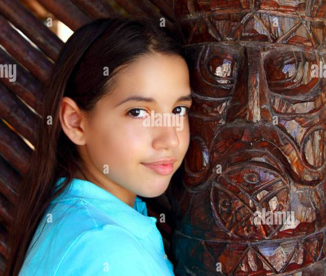 Latin Mexican Teen Girl Smile With Indian Wood Totem