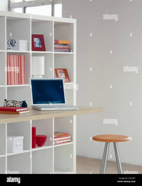 Home office  Modern white grid shelving and storage with desktop and     Modern white grid shelving and storage with desktop and stool