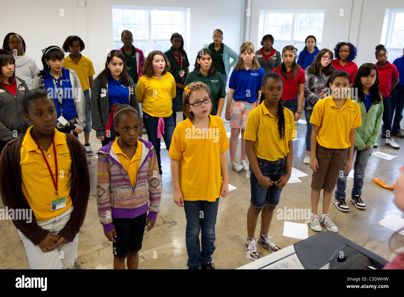 Middle School Students Warm Up In Choir Practice At