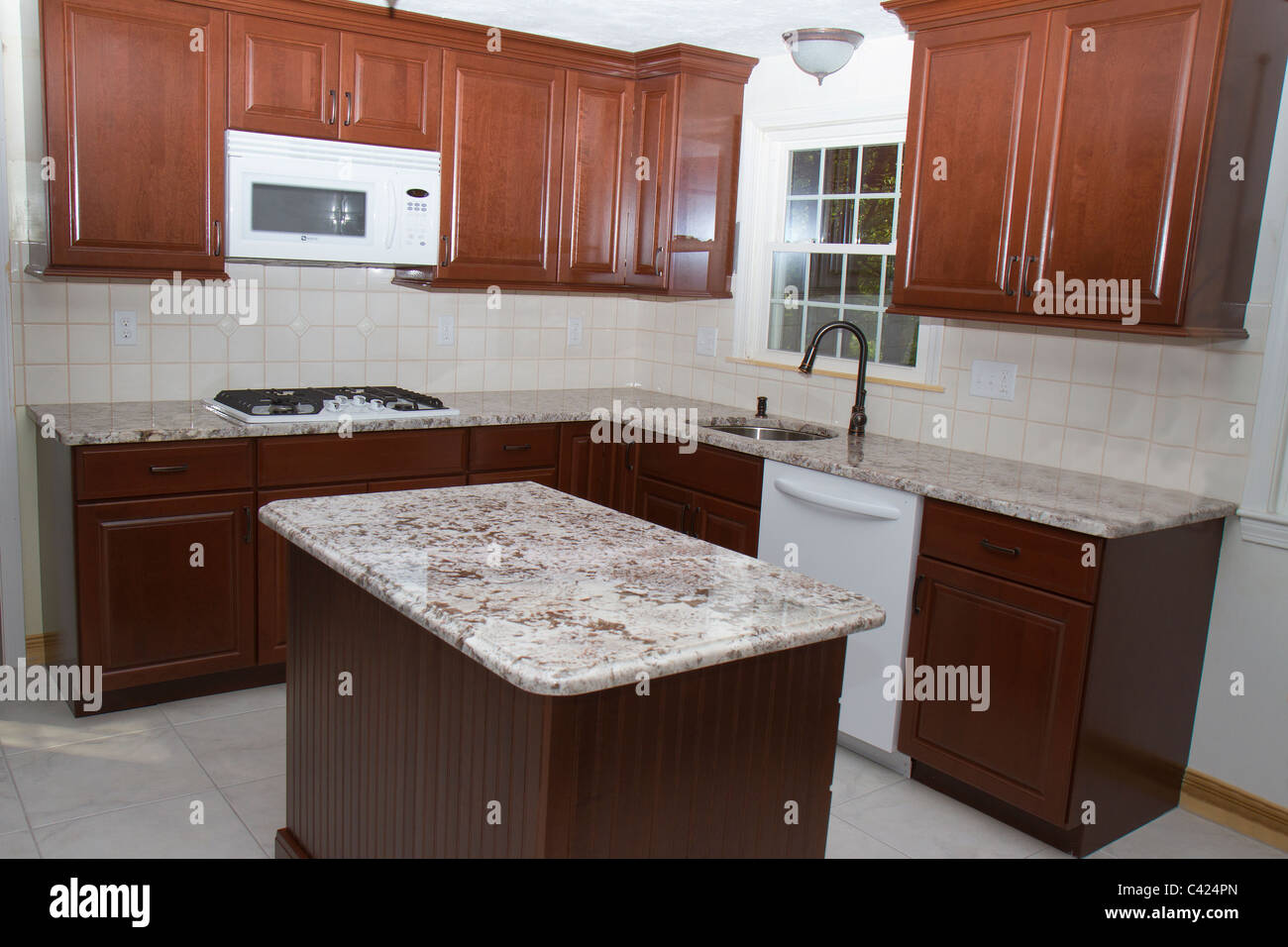 https www alamy com stock photo new cherry cabinets granite counter tops and ceramic tile floor highlight 36927037 html