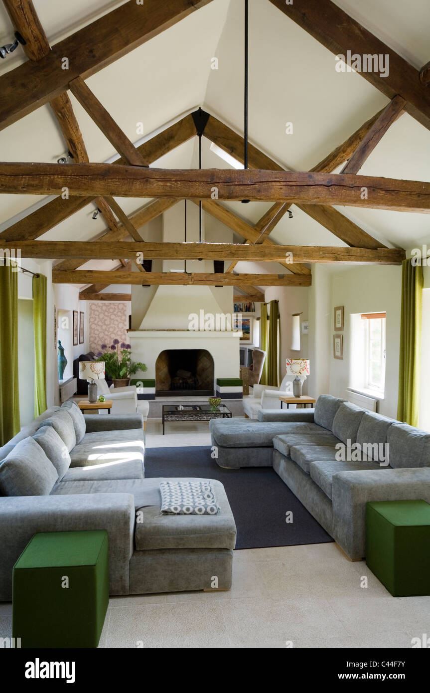 Open Plan Barn Conversion With Beamed Ceilings Grey Sofas
