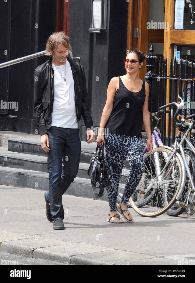 Andy Bell The Bassist For The Rock Band Oasis With His Wife Shiarra Juthan Out For A Stroll Dublin Ireland