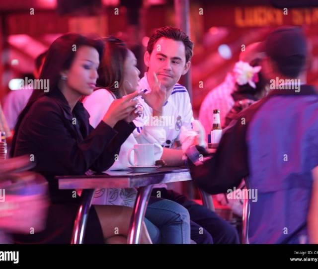Man Talking With Beautiful Thai Prostitute Girl In Gogo Bar Pattaya City Thailand