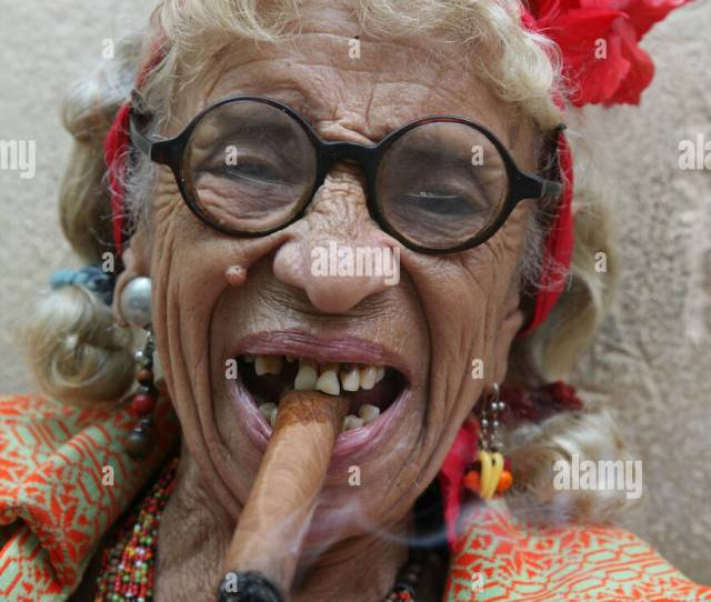 Eccentric Old Cuban Woman Smoking Cigar In The Historical Centre Of Havana Cuba