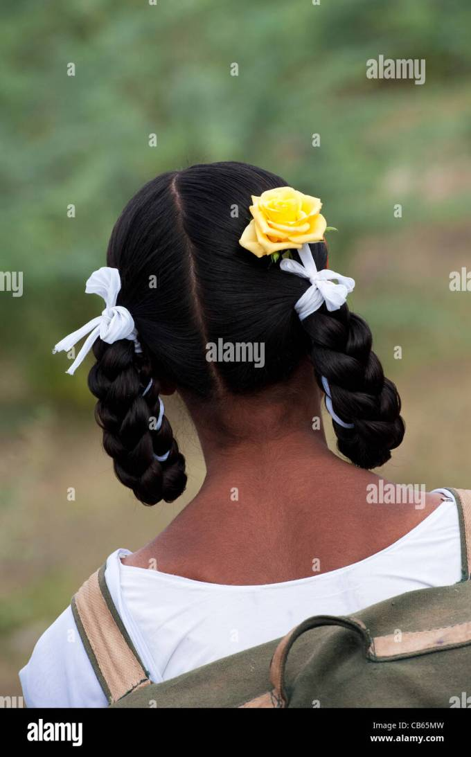 indian school girls traditional hair style with plaits, bows