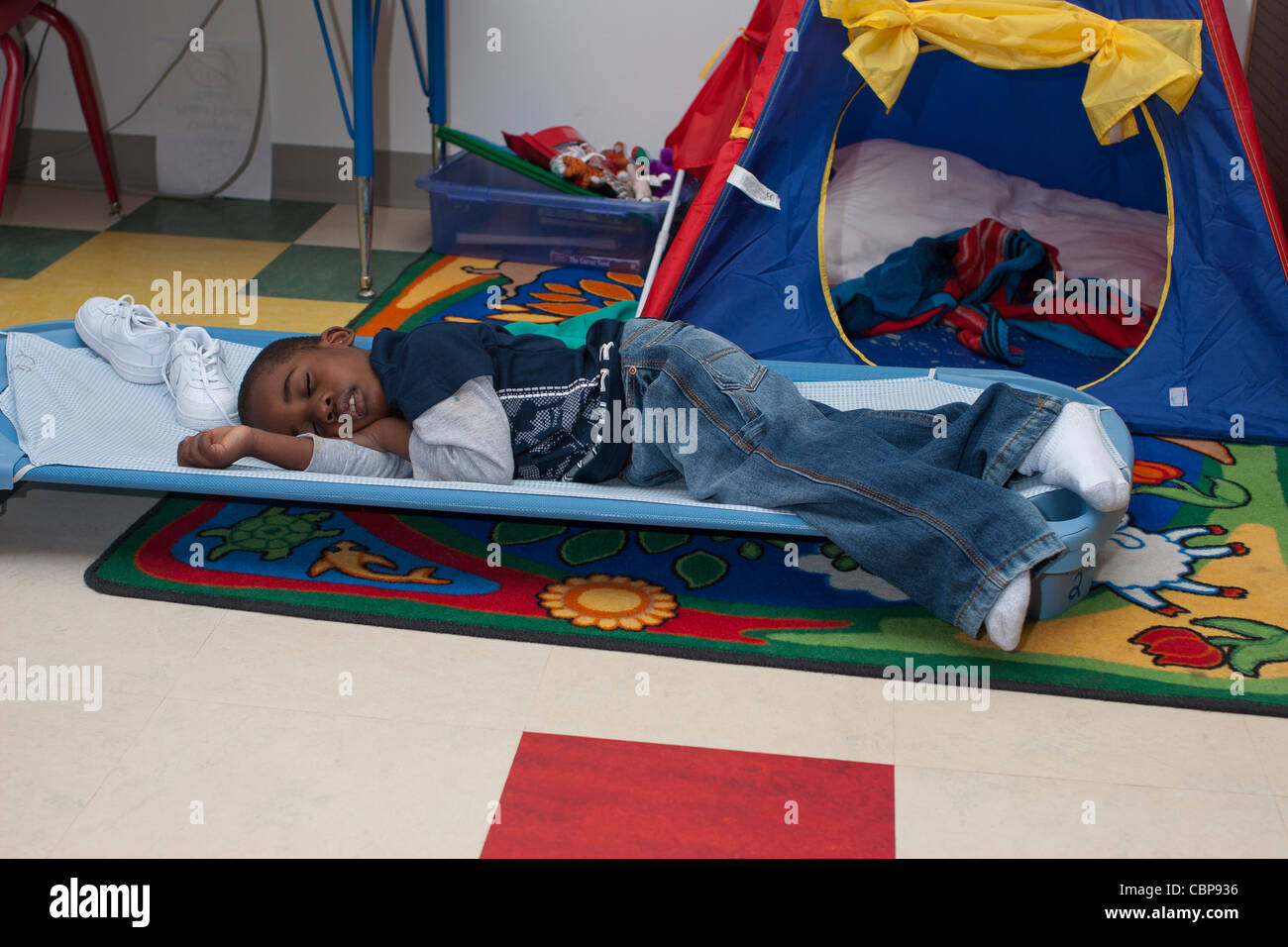 4 Year Old African American Preschool Boy Sleeping On A