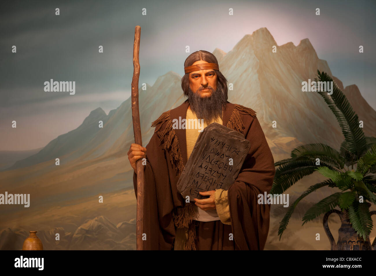Moses Of Old Testament Holding The Ten Commandments Close
