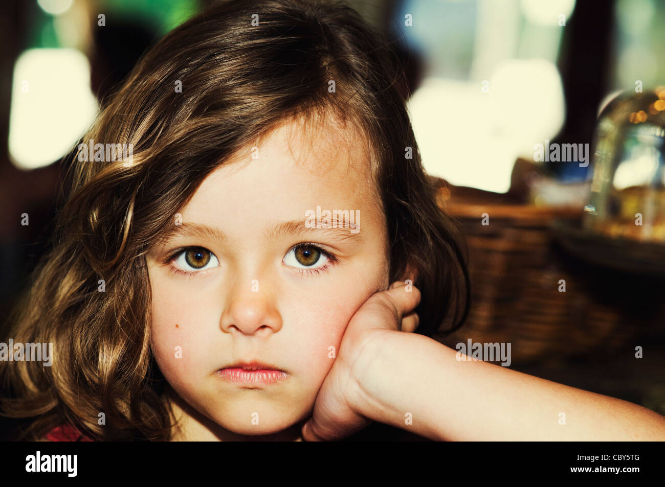 Cute Portrait Of A Young 5 Year Old Brunette Girl Pouting