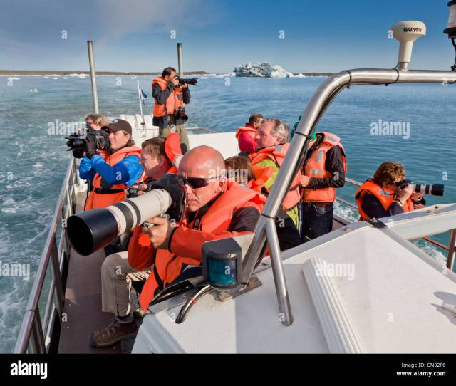 Photographers On Boat Tour Of The Jokulsarlon Glacial Lagoon Breidamerkurjokull Vatnajokull Ice Cap Iceland