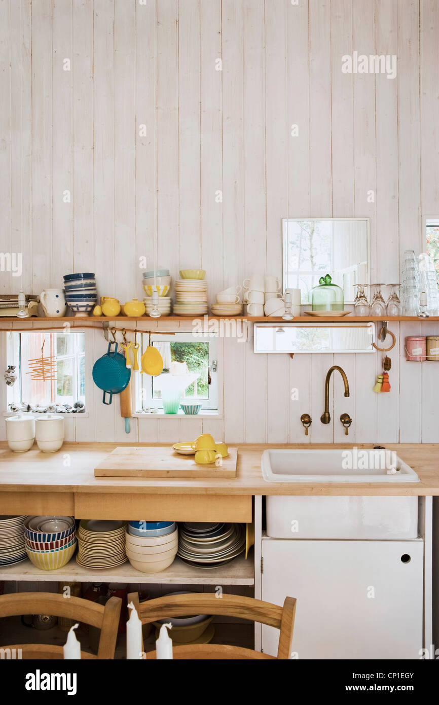 https www alamy com stock photo kitchenware on shelf above sink set in wooden worktop in country style 47976571 html