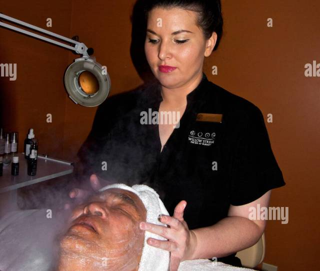 Spa Esthetician Massage Therapist Massaging Asian Man Face Steam Mist