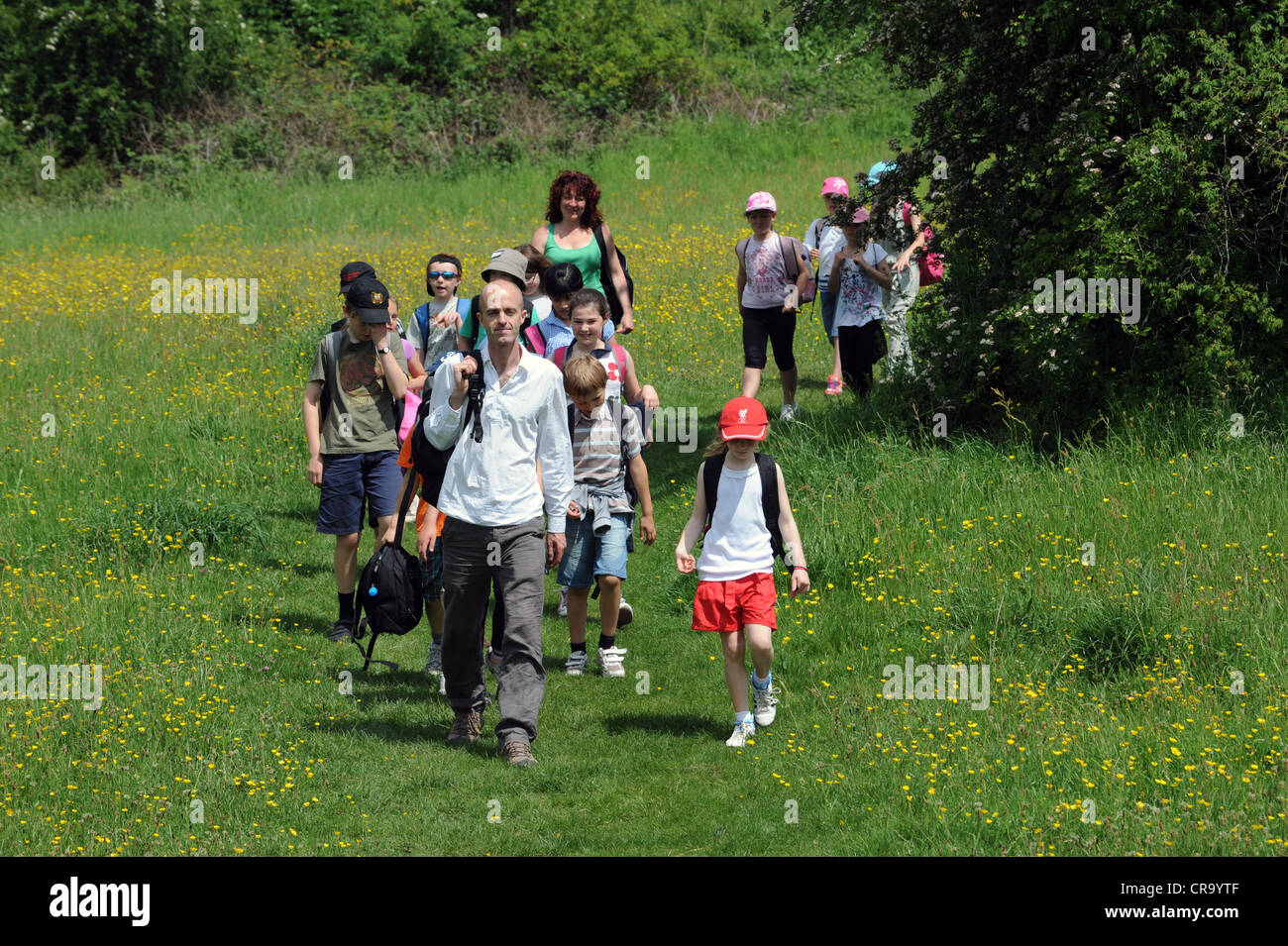 Teacher Leading School Children On A Nature Walk Along The Lodge Stock Photo