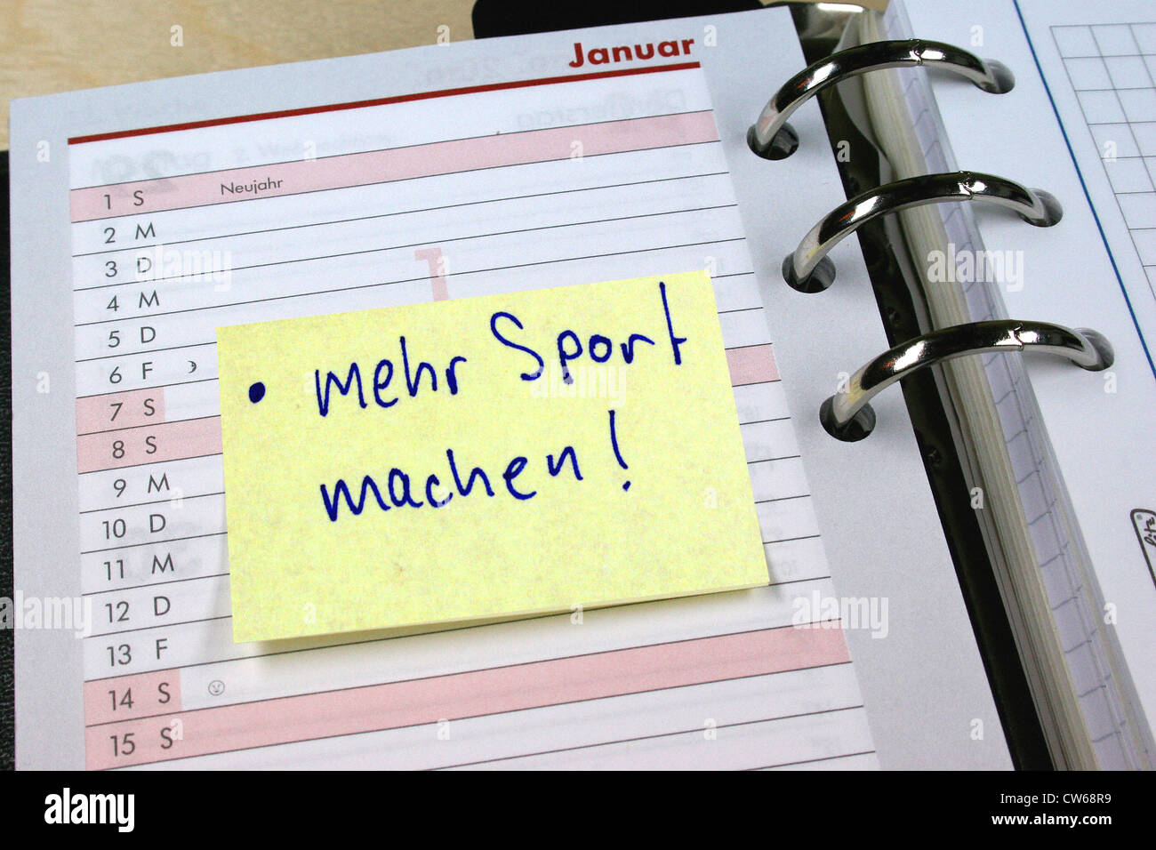 memo with  mehr Sport machen  label in diary  New Year intention     memo with  mehr Sport machen  label in diary  New Year intention  more  sports