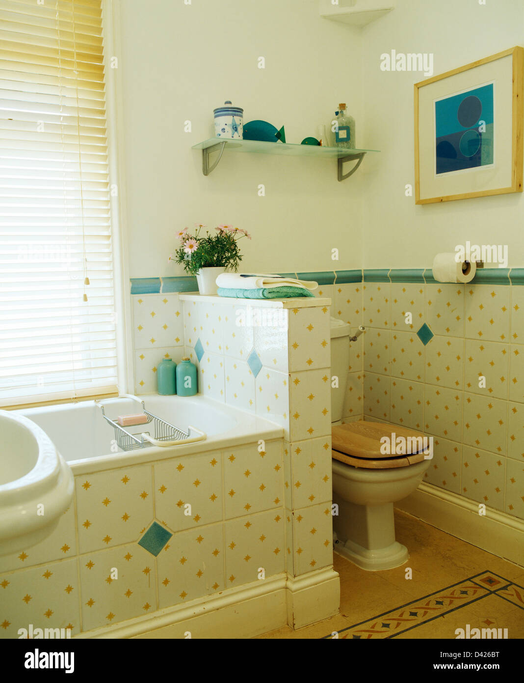 https www alamy com stock photo yellow spotted wall tiles with green tiled border in bathroom with 54138668 html