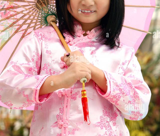 Cute Chinese Girl Holding An Umbrella