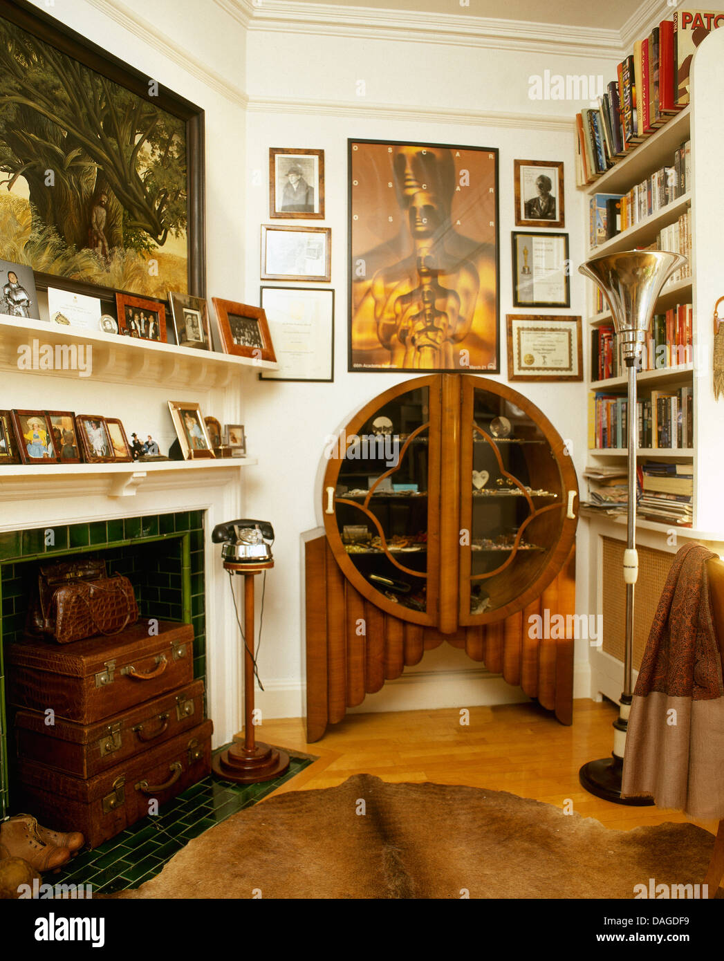 Art Deco Cabinet In Living Room With Old Leather Suitcases
