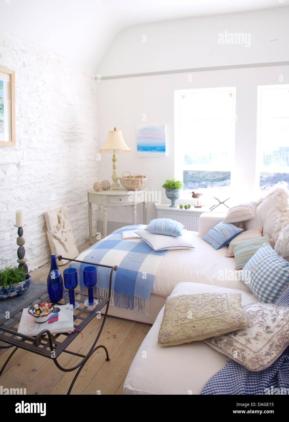 Cushions On White Sofa In White Coastal Cottage Living Room