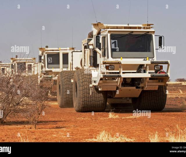 Oil Exploration Mali Seismic Vibrator Vehicles Moving Across Desert And Scrub Terrain On Geophysical Survey Of Concession
