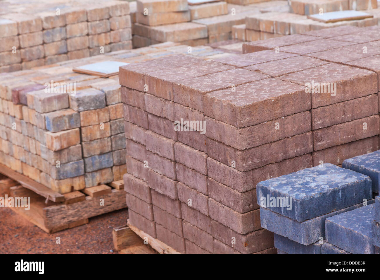 https www alamy com stock photo stacks of various colored concrete pavers paving stone or patio blocks 59915739 html