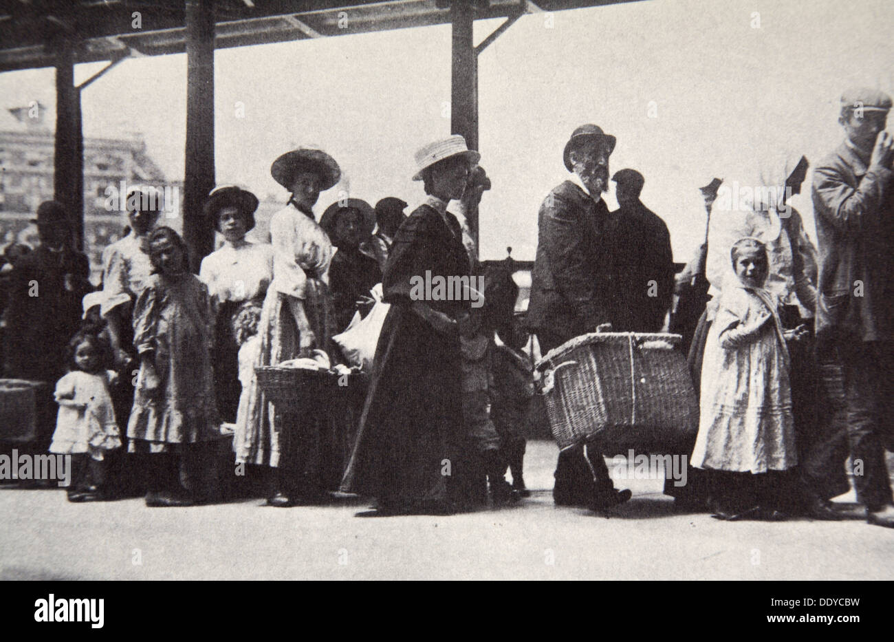 Immigrants Arriving At Ellis Island New York City Usa